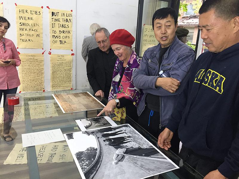 Open Studio visitors, including Beijing artist Shen Shaomin